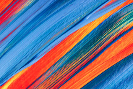 Close-up of abstract painted background in blue and orange colors. Фото со стока