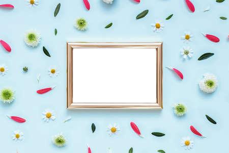 Golden photo frame mockup on flowers pattern background