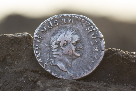 Roman silver coins covered in dirt, ancient denarius