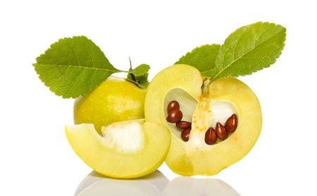 bitter fruit: arrangement of small quince with seeds and grean leaves isolated on white