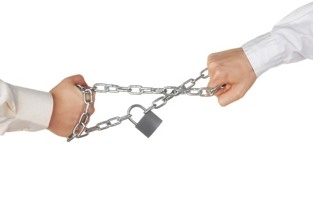 Two hands pulling a locked chain Stock Photo - 10013619