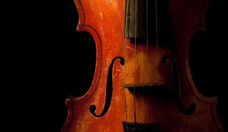 vintage violin detail isolated on black photo