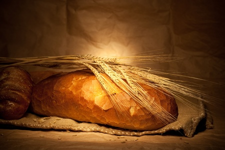 french bread: bread and wheat on sacking still-life Stock Photo
