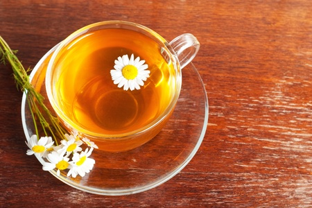 cup of aromatic camomile tea photo