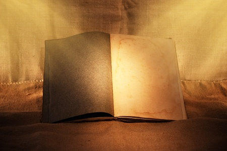 stories: old book in evening ambient light Stock Photo