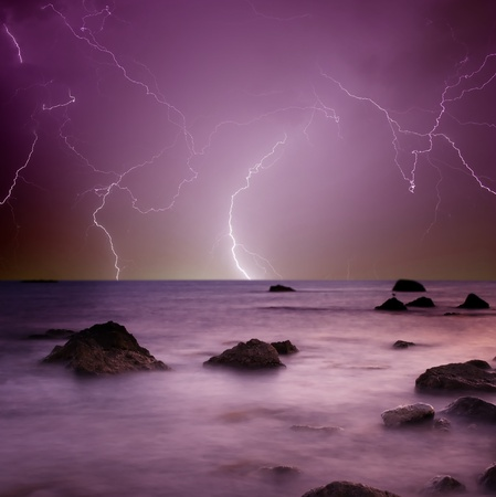 Lightning over sea photo
