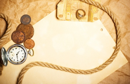 antique money with watch and rope Stock Photo - 12410709