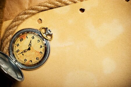 antique watch and rope photo