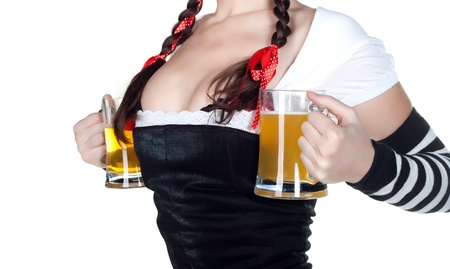 german girl: girl wearing in a traditional german dirndl costume holding two beer steins   Stock Photo