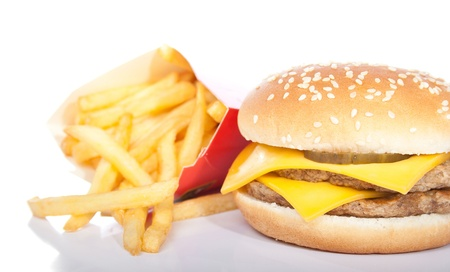 burger and fries: cheeseburger and a box of french fries isolated on white