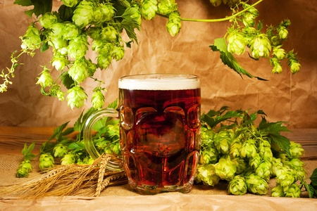 beer and hop on sacking still-life Stock Photo