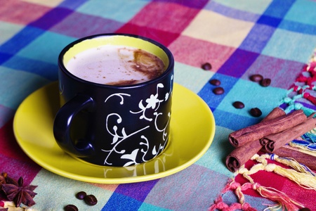 anisetree: coffee with cinnamon and anisetree on multicolored tablecloth