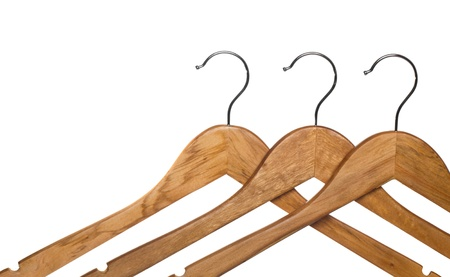 coathanger: three wooden coat hanger isolated on white (focus on middle hanger) Stock Photo