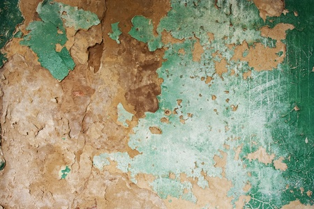 chipped: green weathered painted wall