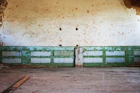 abandoned room with wooden floor and painted wall Stock Photo - 12410684