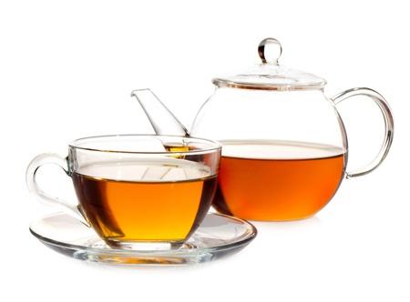 yellow tea pot: tea pot with tea and cup