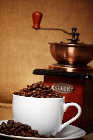 dark coffee still life with retro grinder photo