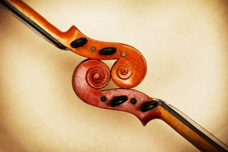 viola: two old violin scrolls detail in ambient light Stock Photo