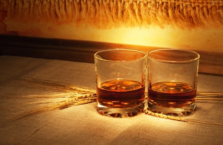 whisky glass: whiskey on sacking with wheat straws