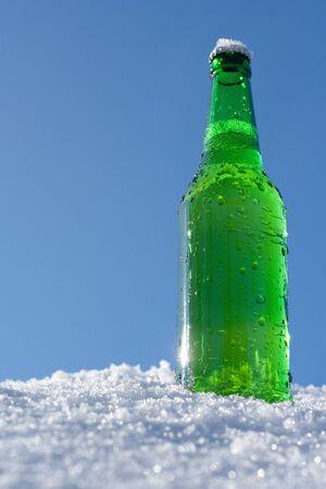 snow drops: beer bottle in snow