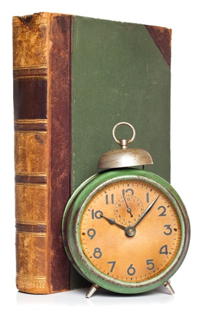 vintage clock and antique book isolated on white photo