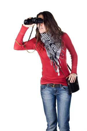 girl looking through binoculars photo