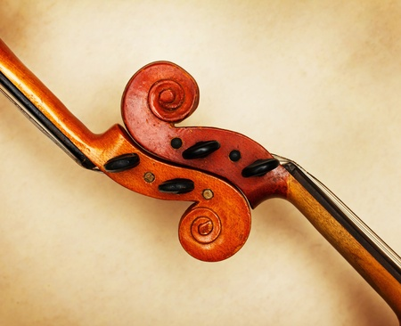 ambient light: two old violin scrolls detail in ambient light Stock Photo