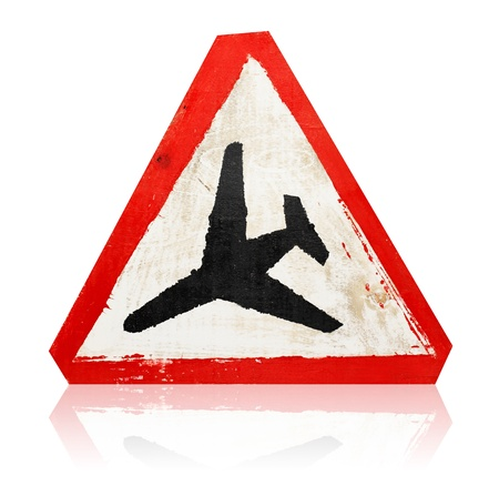 wooden grungy painted &quot,low flying aircraft&quot, road sign isolated on white photo