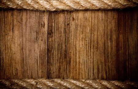 rope background: rope on weathered wood background