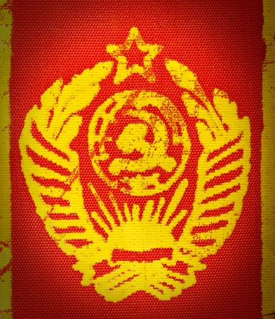 Vintage USSR State Emblem on printed on red fabric photo