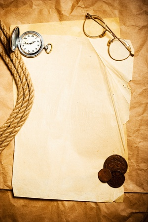 antique money with watch, glasses and rope  photo