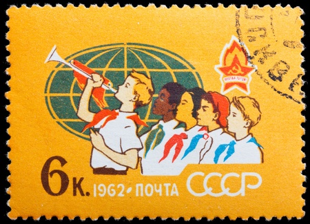 pioneers: RUSSIA - CIRCA 1962: A stamp printed in the USSR, shows international Pioneers, circa 1962