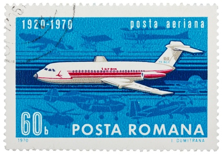 ROMANIA - CIRCA 1970: Stamp printed in Romania shows image of the flying jet plane, symbol of air mail, circa 1970  photo