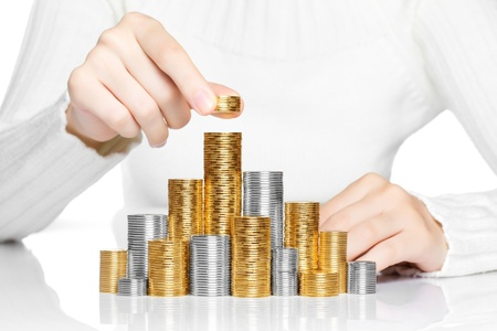 Hand put coin to stack, investment or growth concept photo