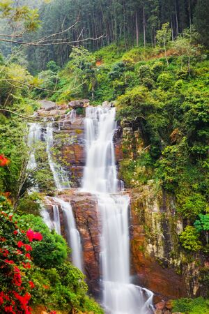 Waterfall in mountains photo