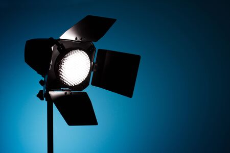 snoot: Studio spot light on blue background Stock Photo