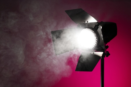 Studio spot light with smoke photo