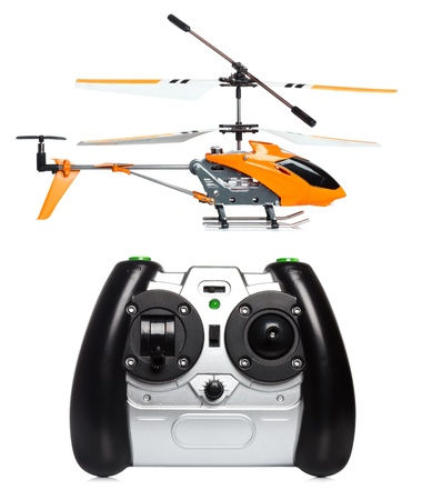 Remote controlled helicopter with controlling handset Stock Photo