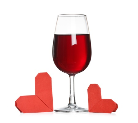 Glass of wine with origami hearts Stock Photo - 12826963