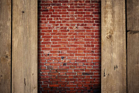 brick wall with wooden boards