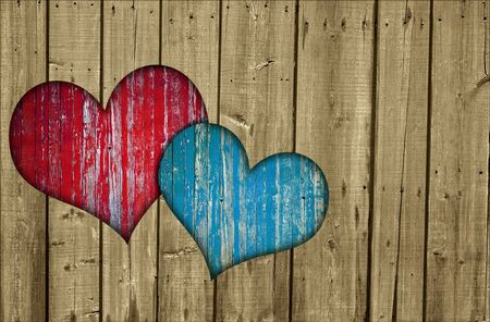 Wooden fence with two hearts Stock Photo - 12827473