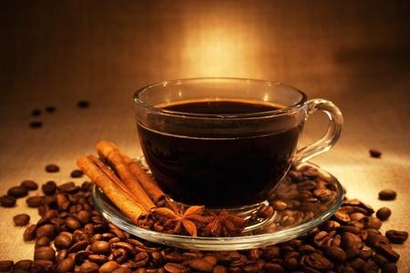 arabic food: dark coffee with cinnamon still-life in dark soft ambient light Stock Photo