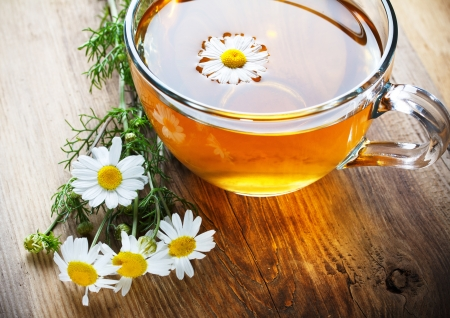 chamomile tea on wooden table photo