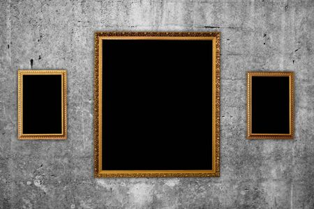 picture frames on concrete wall Stock Photo - 12828347