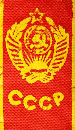 bandera rusia: Vintage emblema del estado en la URSS, impreso en tela roja Editorial