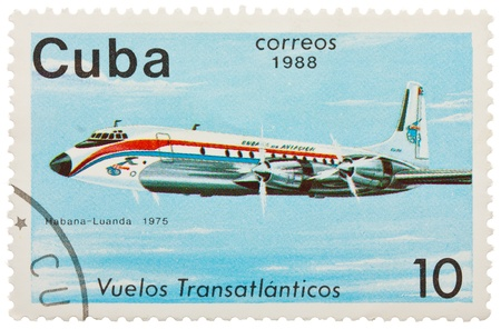 CUBA - CIRCA 1988: A Stamp printed in CUBA shows image of the airplane in transatlantic flight, Habana - Luanda in 1975, circa 1988 Editorial