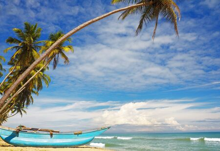 Sri-Lanka sunny coast with fishers boat photo