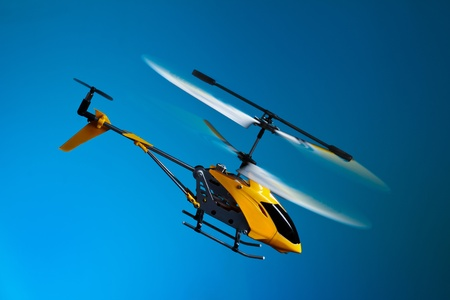Flying remote controlled helicopter photo
