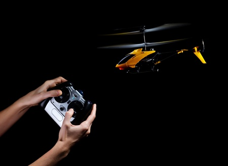 Piloting remote control helicopter photo