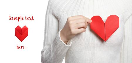Valentines day banner with girl holding origami heart photo
